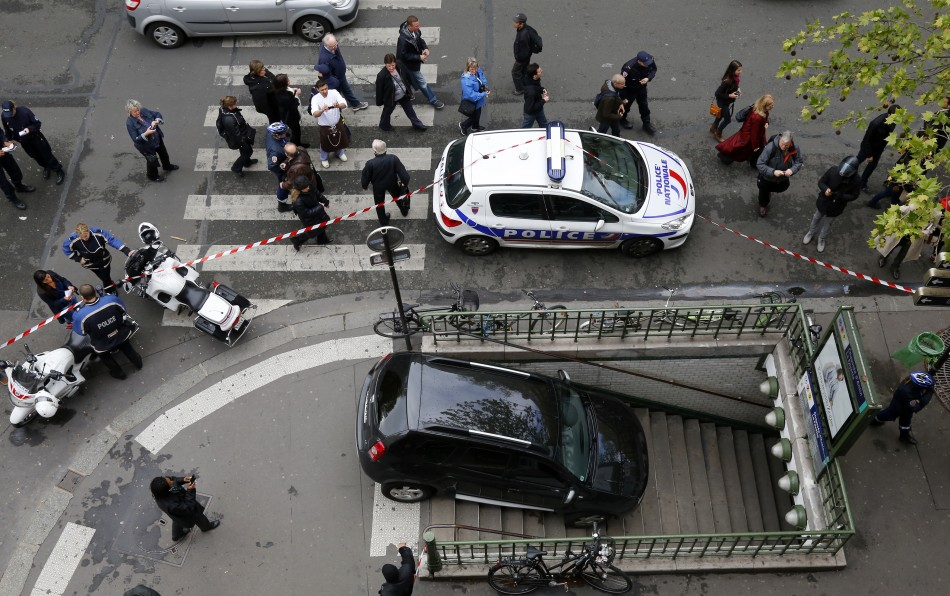 man parks car on metro station stairs in paris photos. Black Bedroom Furniture Sets. Home Design Ideas
