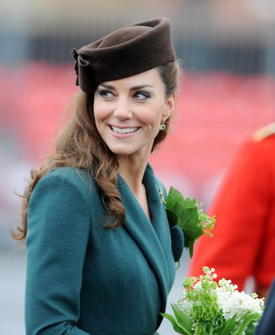 Britains Catherine, Duchess of Cambridge holds a glass of sherry in the Junior Mess during a visit to Aldershot Barracks in Aldershot