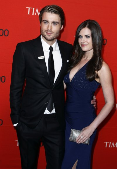 CEO of Mashable, Pete Cashmore, arrives with photographer Lisa Bettany to be honored at the Time 100 Gala in New York
