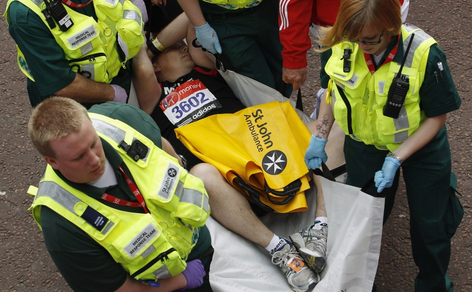 Runner is attended by medics after finishing London Marathon