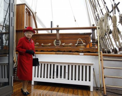 Queen in Regal Red as She Reopens Cutty Sark