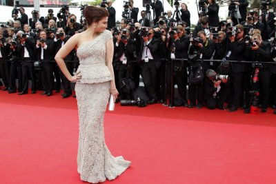 Bollywood actress Aishwarya Rai Bachchan poses on the red carpet for the opening ceremony of the 64th Cannes Film Festival in Cannes 2011