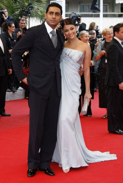 Bollywood actress Aishwarya Rai Bachchan and actor Abhishek Bachchan pose on red carpet as they arrive at 62nd Cannes Film Festival 2009