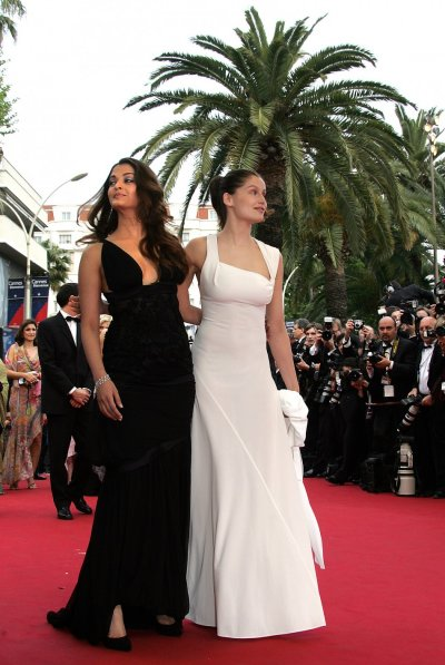 Laetitia Casta poses with Aishwarya Rai during red carpet arrivals on festival opening night in Cannes 2004