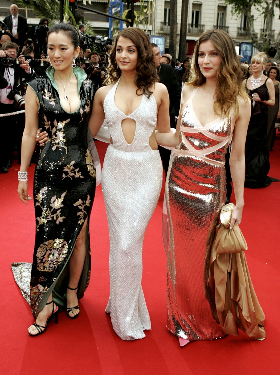 Chinese actress Gong Li, Indian actress Aishwarya Rai and French model Laetitia Casta pose during red carpet arrivals on the first day of the 57th International film festival in Cannes 2004