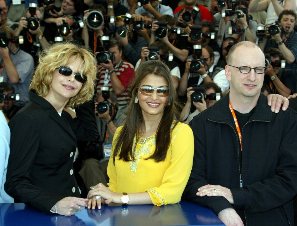 Jury members, US actress Meg Ryan L, Indian actress and former Miss World Aishwarya Rai C, and US director Steven Soderbergh R stand together during a photocall on the first day of the 56th International Film Festival in Cannes 2003