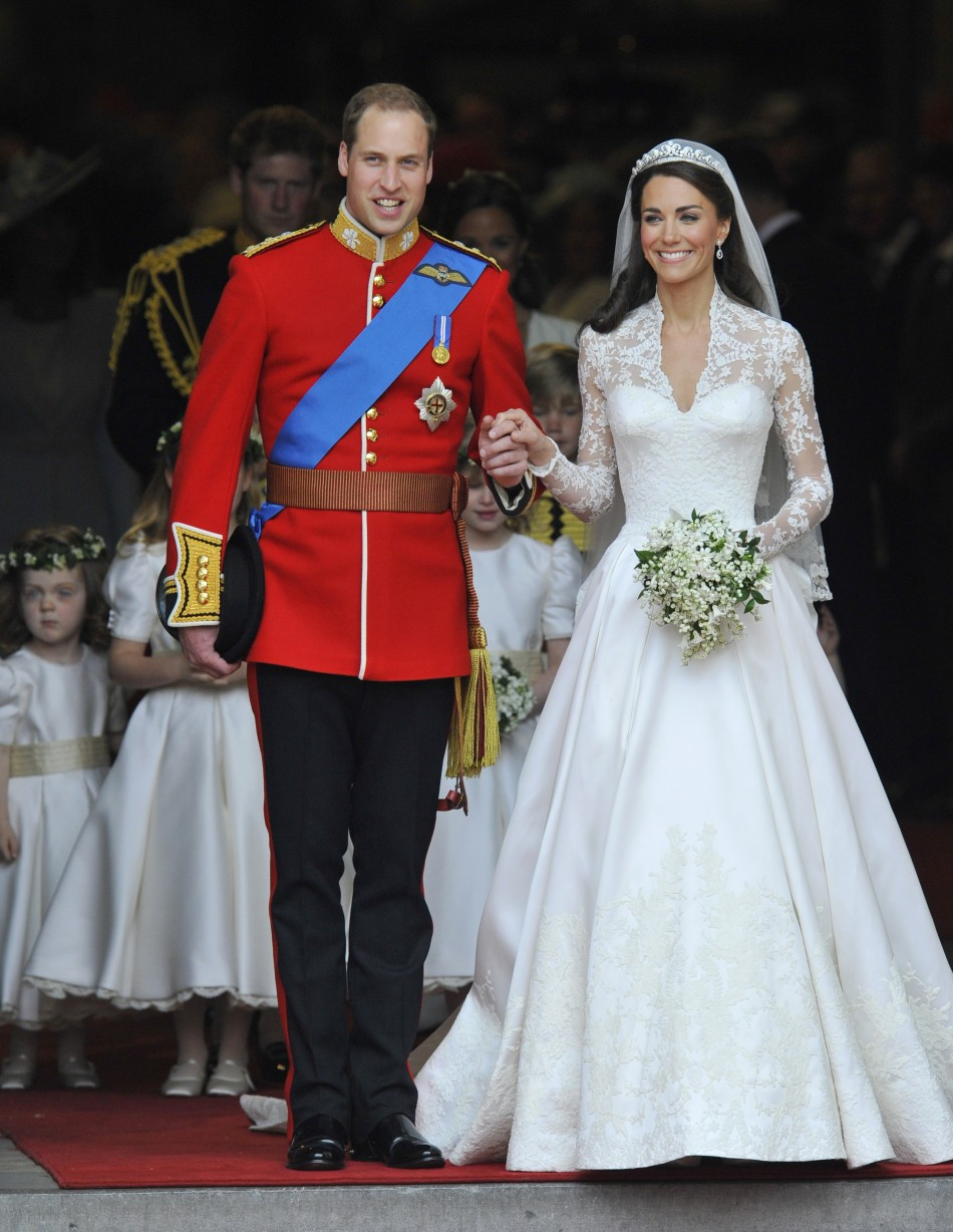 Britain's Prince William and Catherine, Duchess of Cambridge, walk after their wedding ceremony in Westminster Abbey