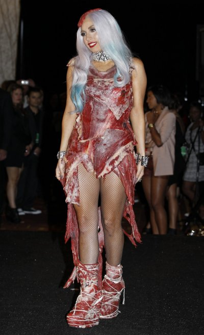 Lady Gaga wearing an outfit made of meat poses in the photo room at the 2010 MTV Video Music Awards in Los Angeles