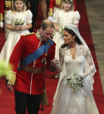 Britain039s Prince William and his bride hold hands in Westminster Abbey