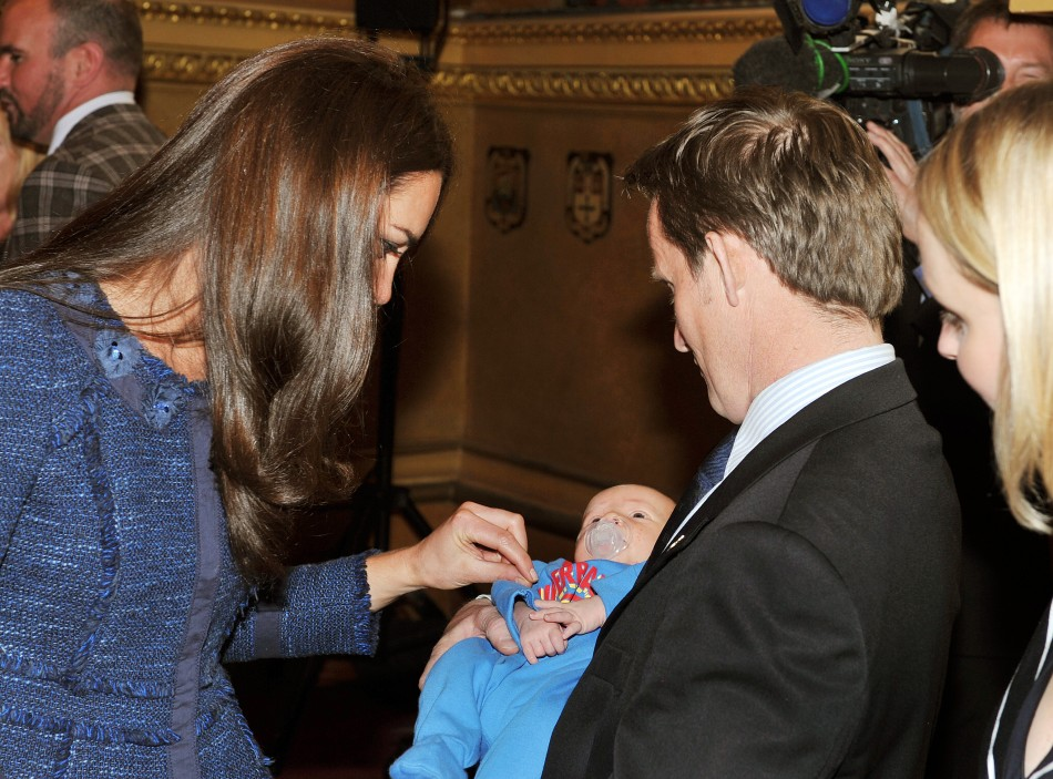 The Duchess of Cambridge talks to Vic Vicary, holding his three week old son Hugo Eric Scott Vicary, at a reception to celebrate the Scott-Amundsen Centenary Race to the South Pole, at Goldsmiths Hall in the City of London