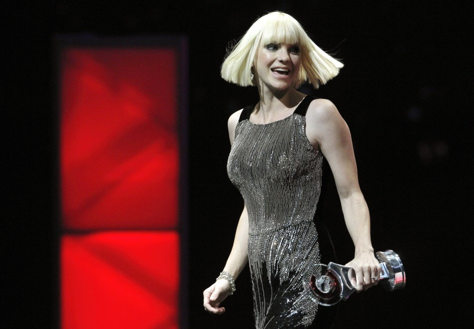 Anna Faris leaves the stage after accepting the Comedy Star of the Year Award during the CinemaCon Big Screen Achievement Awards show in Las Vegas