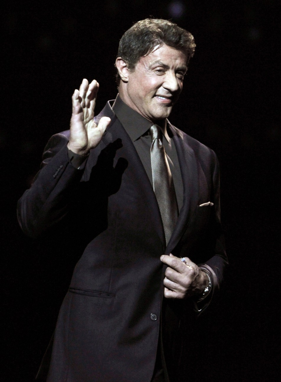 Actor Sylvester Stallone, recipient of the Career Achievement Award, arrives on stage during the CinemaCon Big Screen Achievement Awards show in Las Vegas