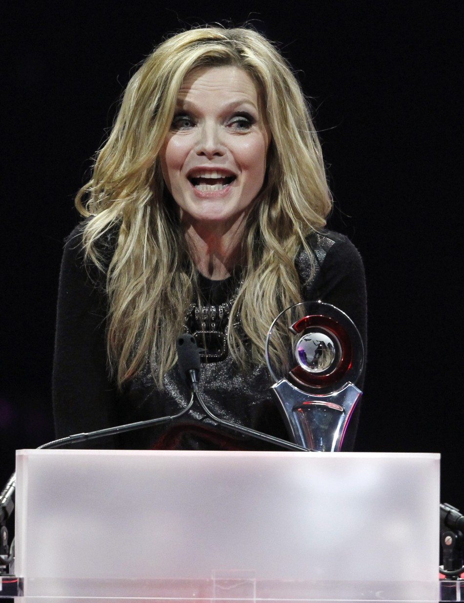 Michelle Pfeiffer accepts the Cinema Icon Award during the CinemaCon Big Screen Achievement Awards show in Las Vegas