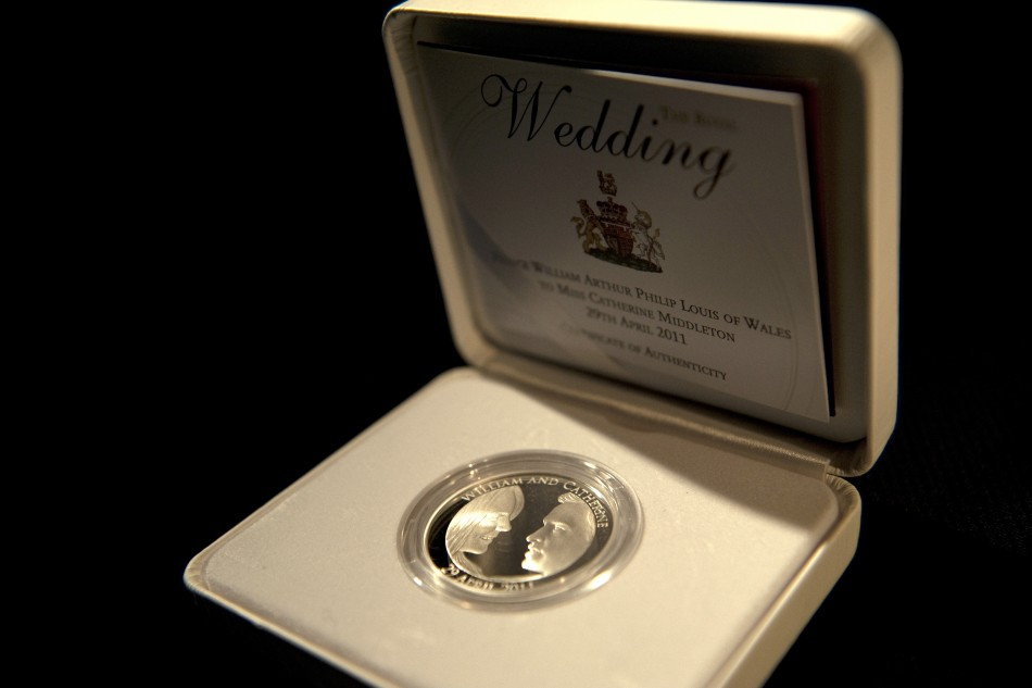 A packaged five pound Royal Wedding commemorative coin is seen at the Royal Mint in Cardiff