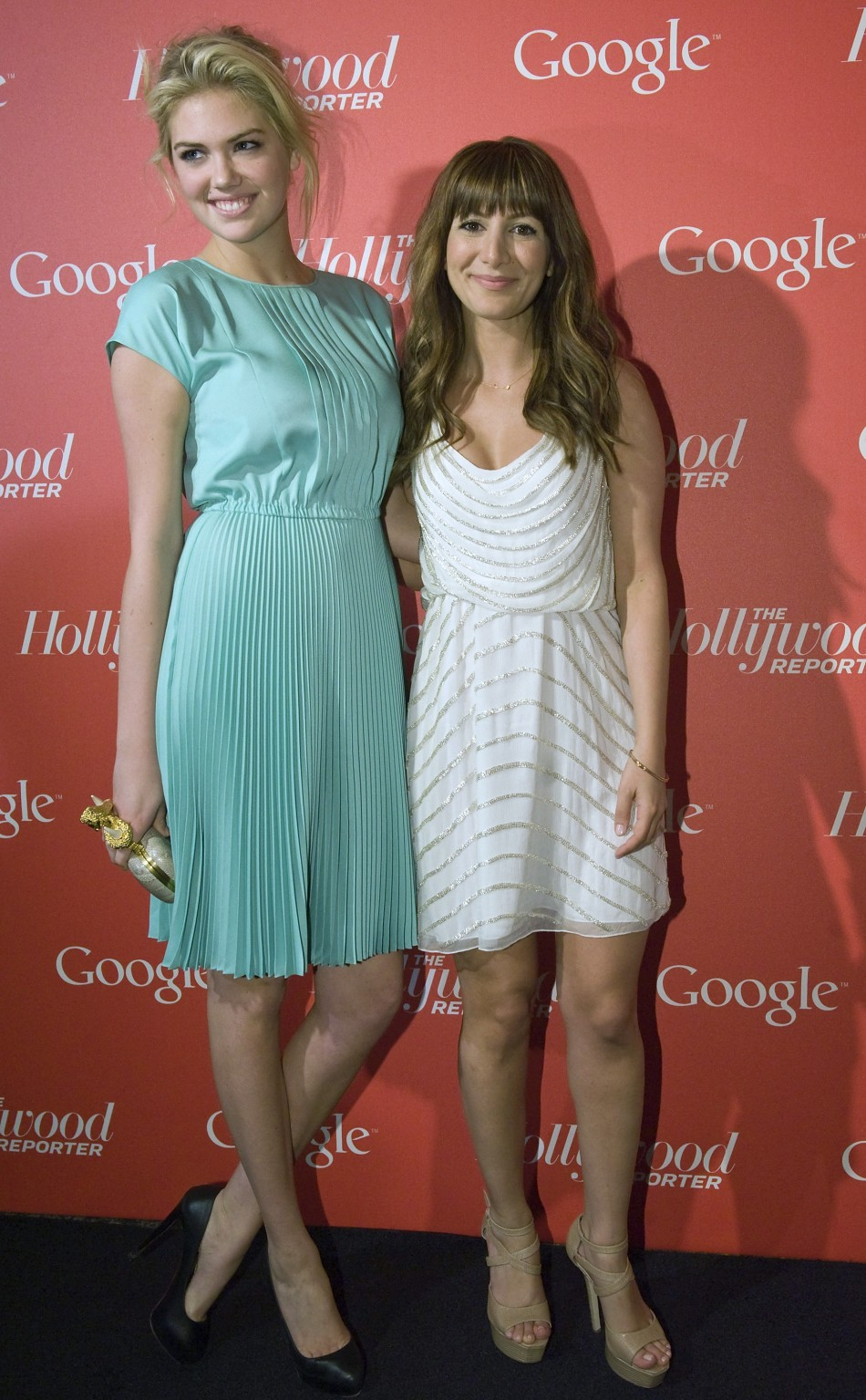 Model Kate Upton L and comedienne Nasim Pedrad