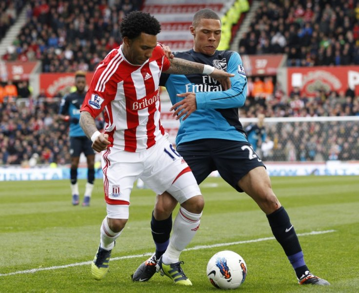 Kieran Gibbs and Jermaine Pennant Battle for the Ball