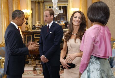 U.S. President Barack Obama and first lady Michelle Obama talk to Britains Prince William and Catherine, Duchess of Cambridge at Buckingham Palace, in London