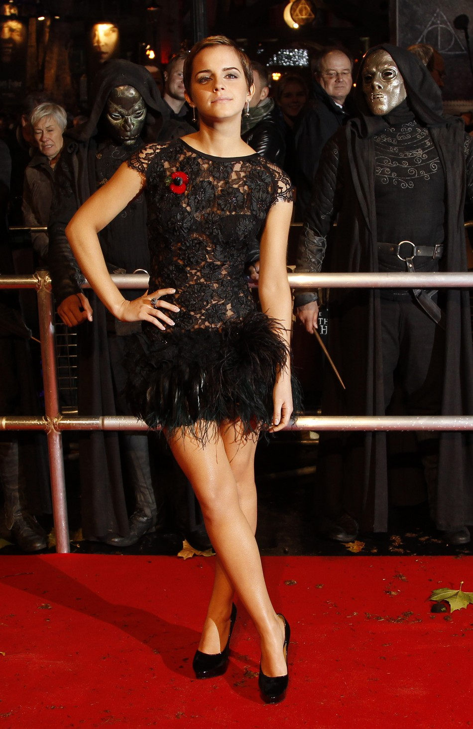 "Britain's Watson poses as she arrives for the world film premiere of ""Harry Potter and the Deathly Hallows: Part 1"" in London 2010"