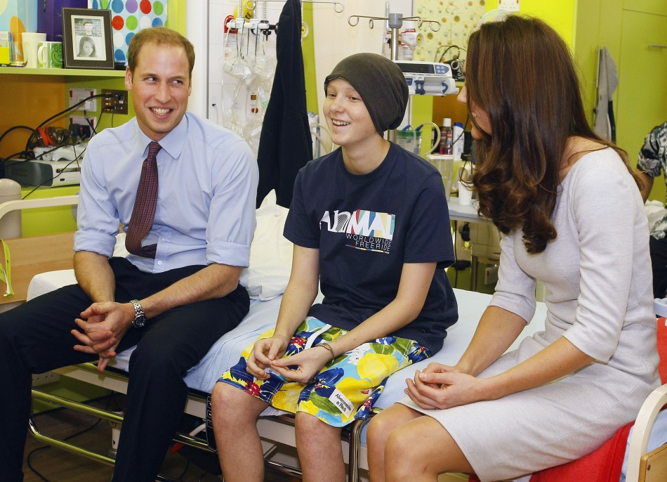 Britain's Prince William and his wife Catherine, Duchess of Cambridge meet patient Digby Davidson, 14, at the new Oak Centre for Children and Young People at The Royal Marsden Hospital in Sutton, Southern England