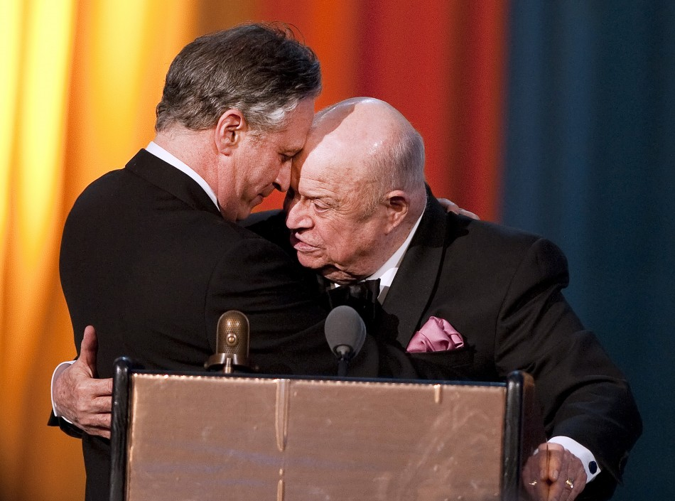Comedian Don Rickles hugs Jon Stewart after receiving the Johnny Carson Award during the second annual 2012 Comedy Awards in New York