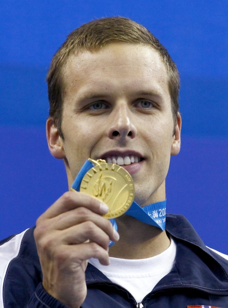 Alexander Dale Oen displays gold medal won in men's 100m breaststroke final at Fina World Championships last year in Shanghai