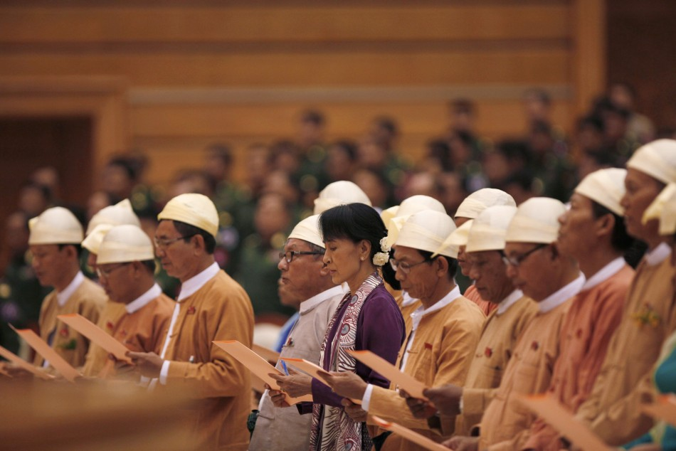 Myanmar pro-democracy leader Aung San Suu Kyi (C) and members of parliament from the National League for Democracy take their oaths