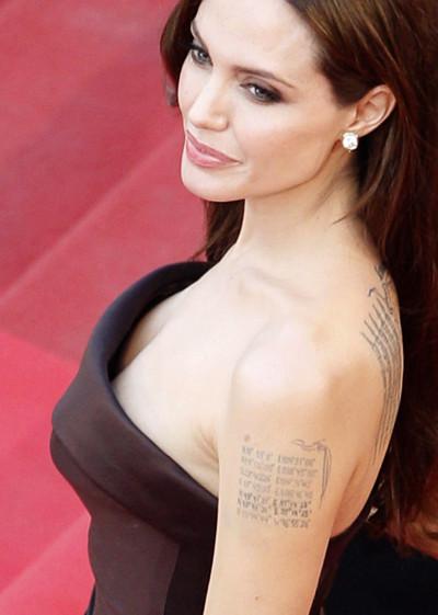 Angelina Jolie with her tatoos