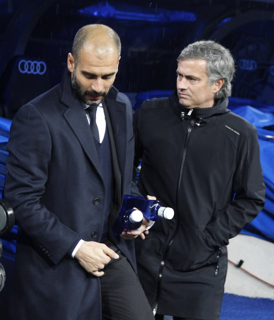 Barcelona's coach Guardiola greets Real Madrid's coach Mourinho