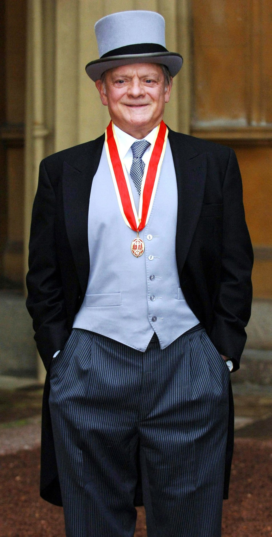 British actor David Jason stands after collecting his knighthood from Britain's [Queen Elizabeth II] during an investiture ceremony at Buckingham Palace in central London December 1, 2005. Sir David, as he will be known, is the popular star of television'