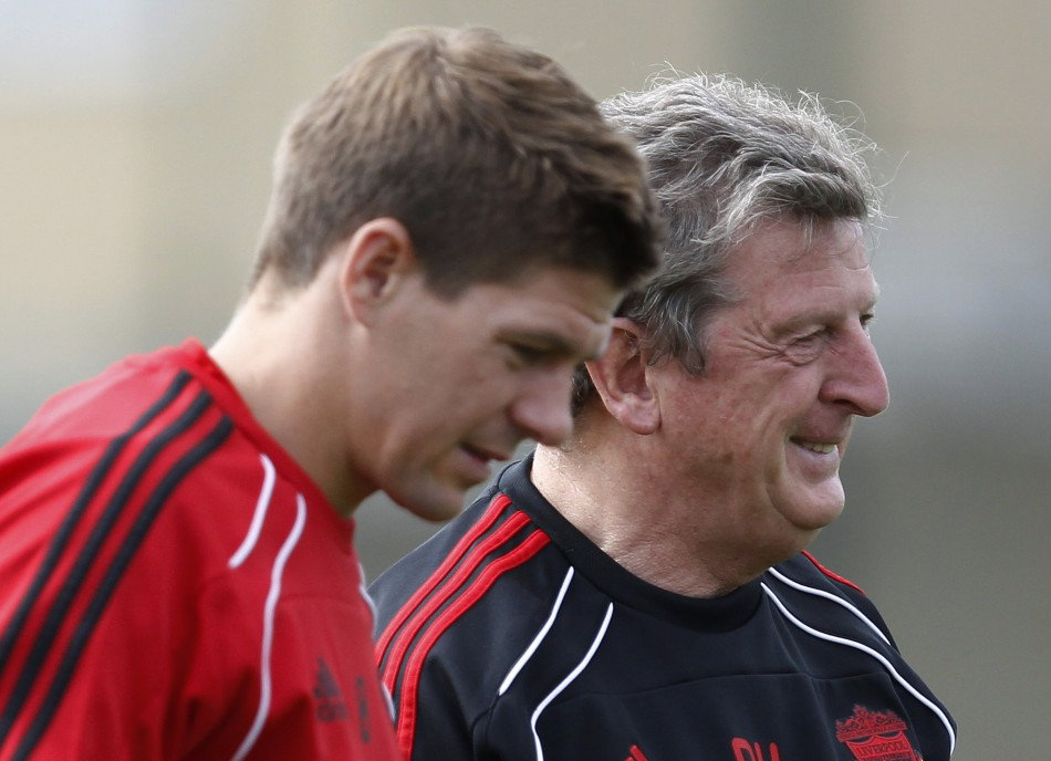 Liverpool's Gerrard stands with manager Roy Hodgson