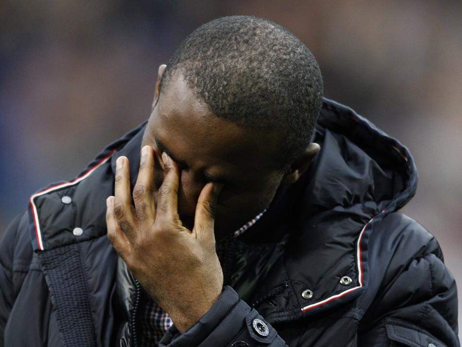 Bolton Wanderers Muamba reacts on his return to the Reebok Stadium