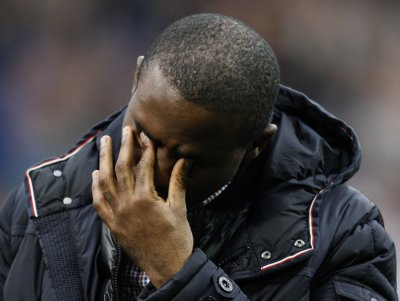 Bolton Wanderers Muamba reacts on his return to the Reebok Stadium