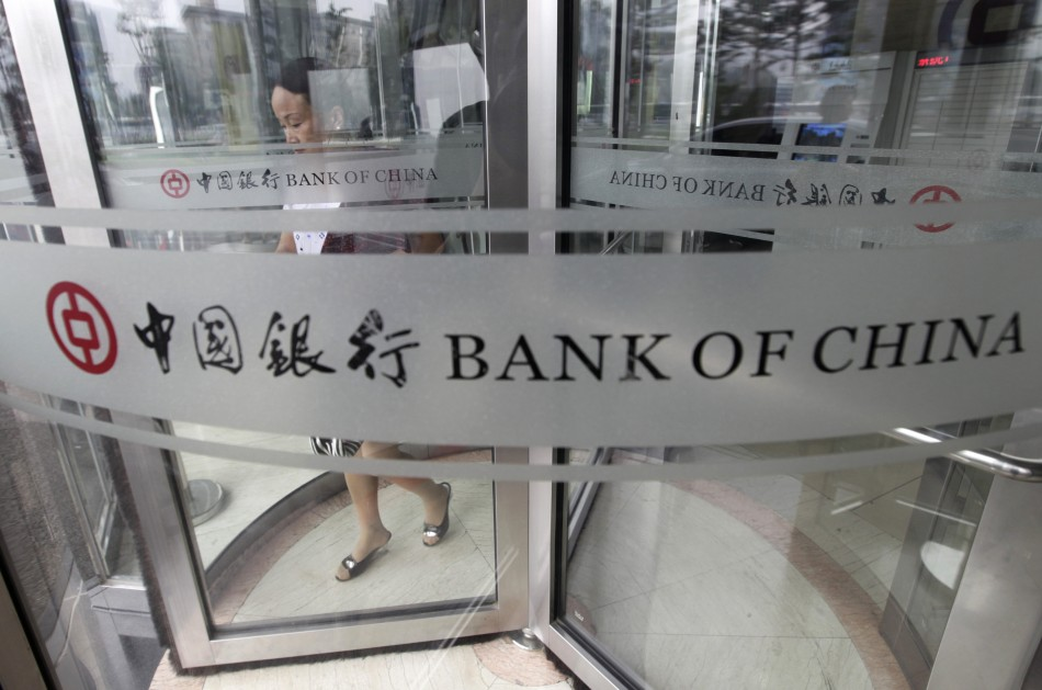 A woman leaves a branch of Bank of China in Beijing