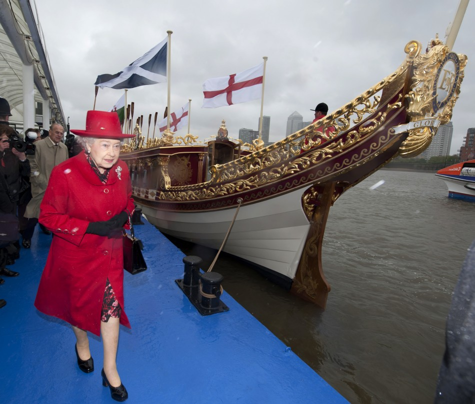 The Queen takes a look at the Gloriana, a new royal barge that will form part of the Thames diamond jubilee pageant