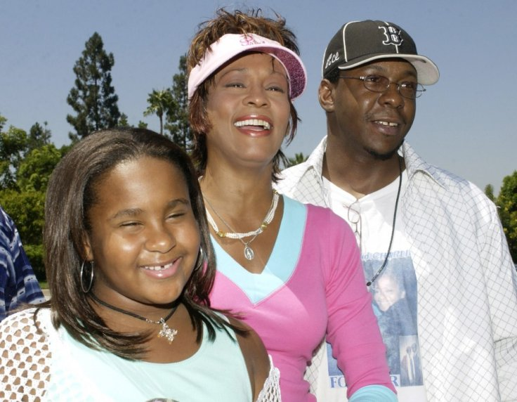 Singer and actress Whitney Houston (C), poses with her husband, singer Bobby Brown (R) and their daughter Bobbi (L)