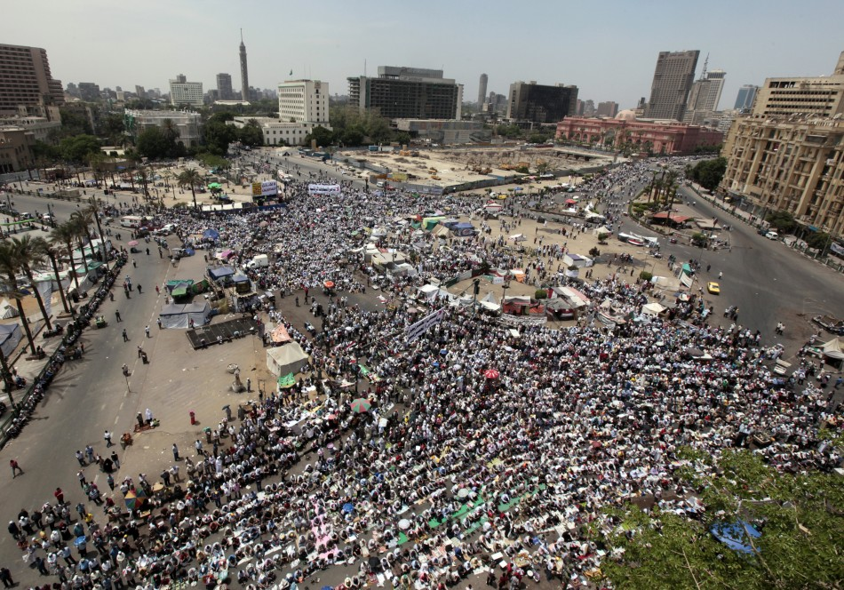 People attend Friday prayers in Tahrir Square in Cairo