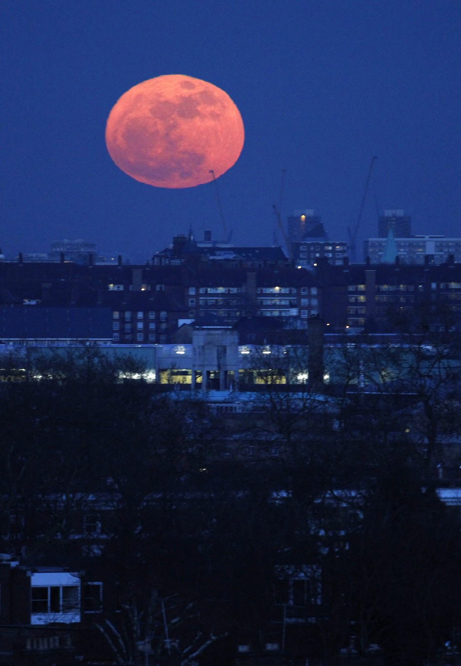 The super moon rises over east London