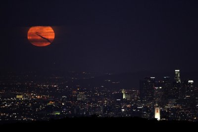 The super moon rises over downtown Los Angeles