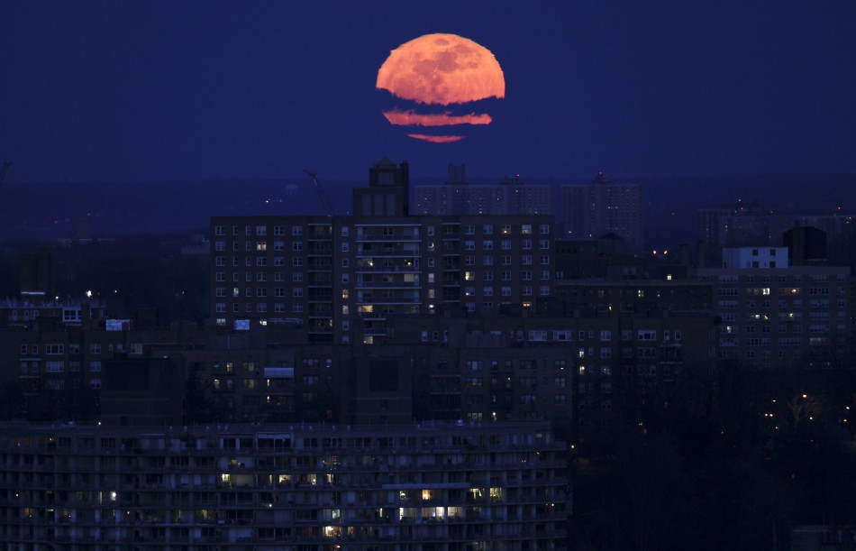 The moon rises over the Bronx section of New York City
