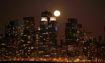 Super moon rises over the skyline of Manhattan along the Hudson River in New York