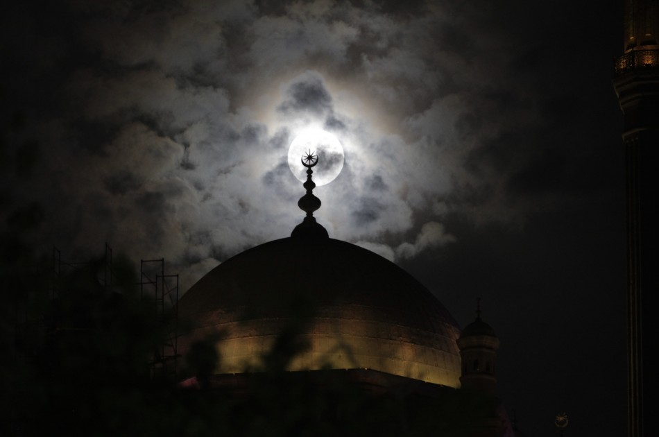 A full moon is seen in Cairo