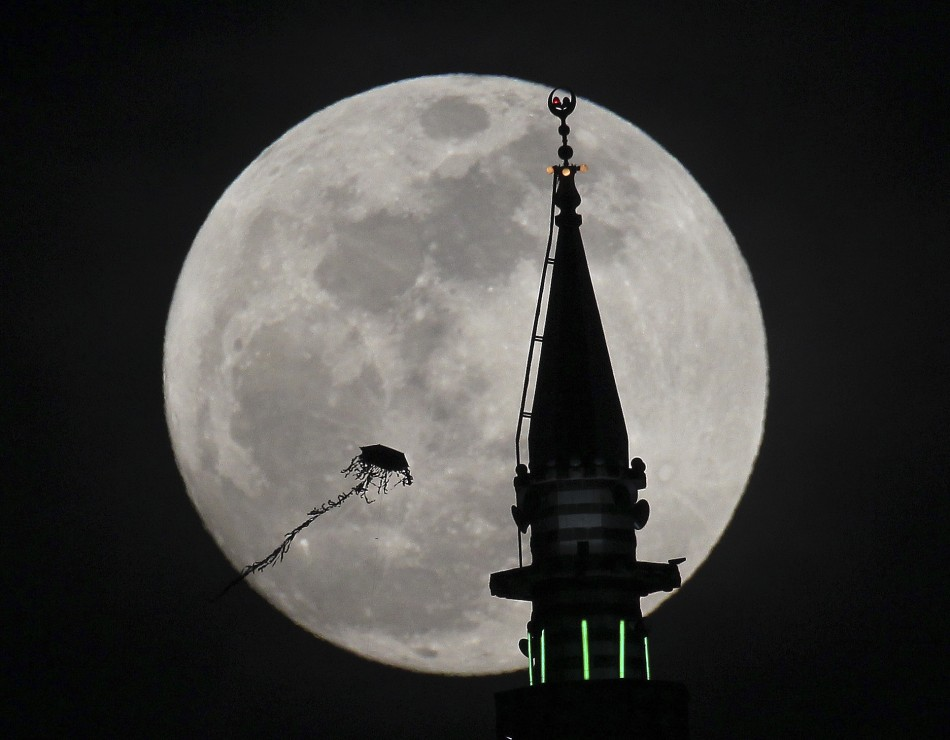 The full moon rises in Amman