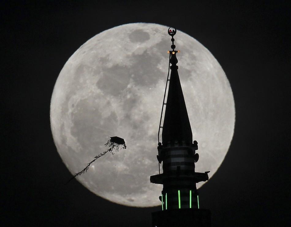 The full moon rises in Amman