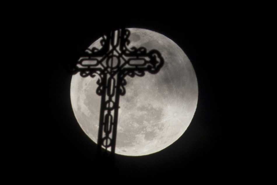 A view of the quotsuper Moonquot is seen with a silhouette of a church cross from Havana