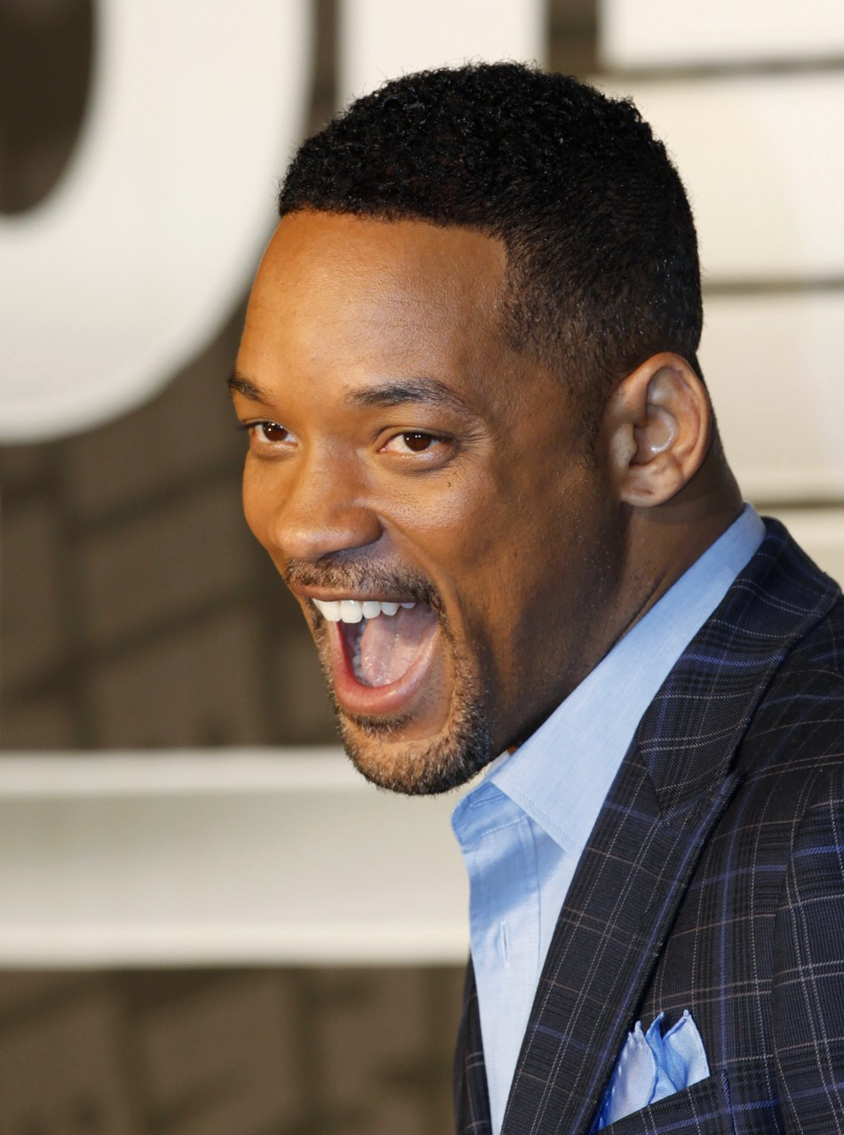 "Cast member Will Smith shouts as he arrives for a news conference to promote his film ""Men in Black III"" in Seoul"
