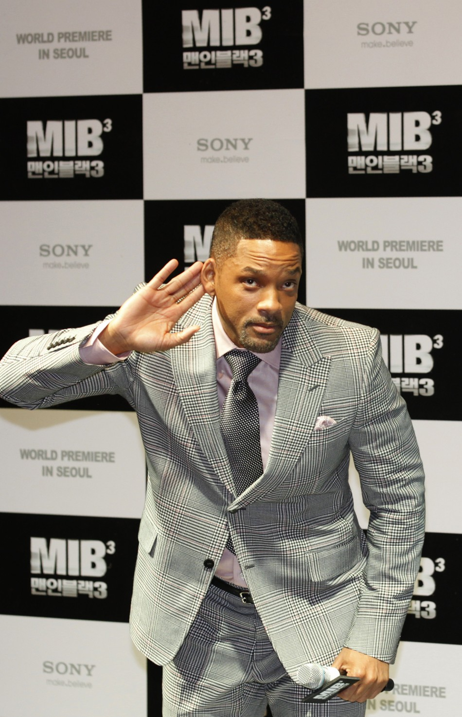 "Will Smith gestures during the world premiere, a red carpet event, for his film ""Men in Black III"" at a theatre in Seoul"