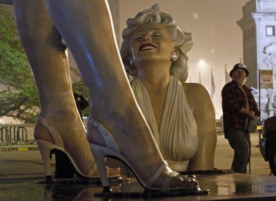 A worker looks at a disassembled 26-foot tall statue of Marilyn Monroe in Chicago