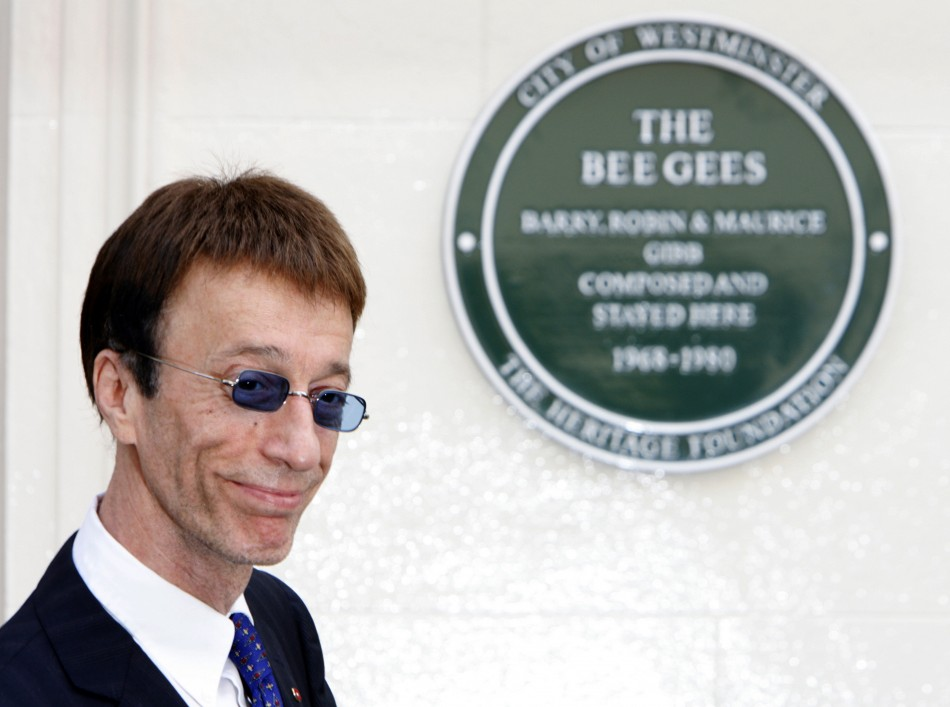 Robin Gibb is out of a coma but remains critically ill in hospital (Reuters)