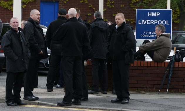 Prison officers gather outside HMP Liverpool after walking out of work  (Reuters)