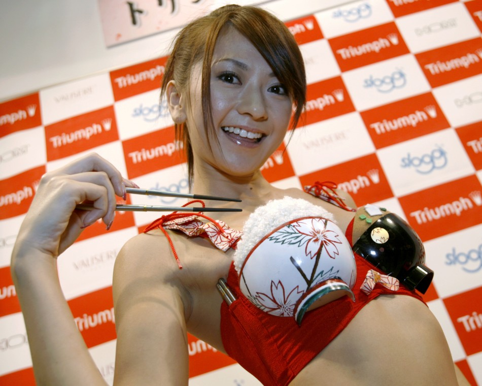Triumph International Japans new promotional girl Yuko Ishida poses with the concept bra called My Chopsticks Bra in Tokyo